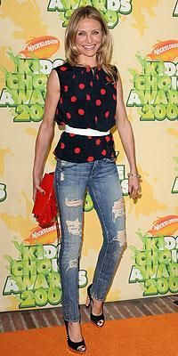 Who made Cameron Diaz's red polka dot shirt, ripped jeans, red purse, jewelry and black shoes that she wore to the Nickelodeon Kids' Choice Awards? Shirt – Michael Kors  Jeans – Seven For All Mankind  Purse – LAI  Bracelet – Gemma  Shoes – DSquared2
