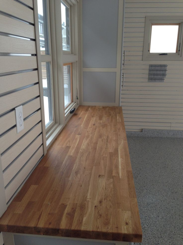Bonnie garage calgary garage renovation slotwall for Ak kitchen cabinets calgary