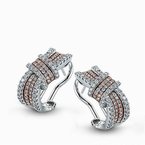 These dramatic contemporary earrings feature a dramatic design set with 1.04 ctw round white diamonds set in a lovely white and rose gold setting.