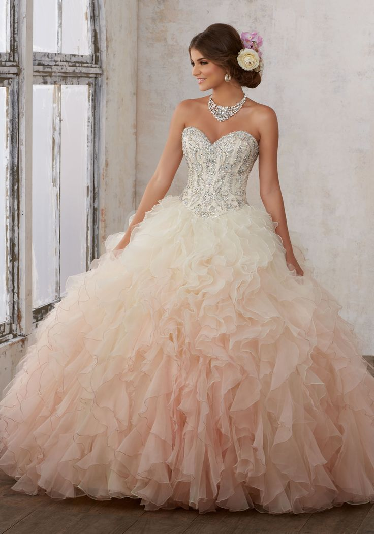 Morilee Quinceanera Dresses  STYLE NUMBER: 89123 Moonstone Jeweled Beading on a Ruffled Organza Ballgown  Organza Quinceañera Dress with Jewel Beaded Sweetheart Bodice. Ruffled Ombre Skirt. Matching Bolero Jacket Included. Colors Available: Champagne/Blush, Light Aqua/Mint, White.