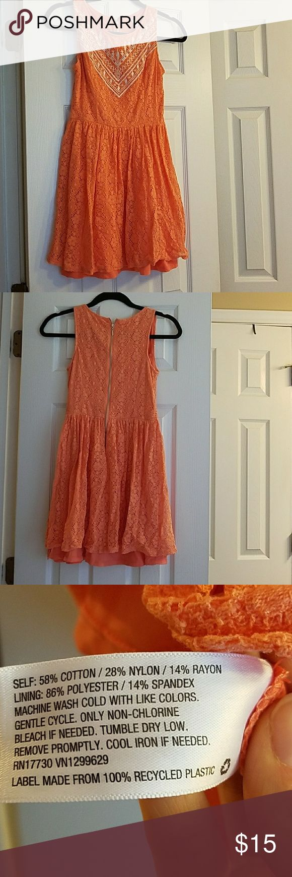 Coral Dress from Target Coral lace dress with white embroidery in the front. Zip back closure. A tighter fitting small. Cute for summer! Xhilaration Dresses Mini