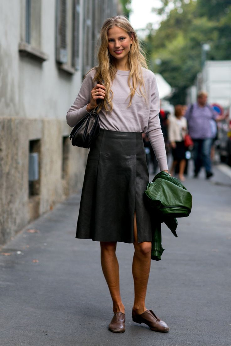 A casual tank top is elevated into a smart outfit with a chic leather skirt