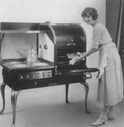 An ad from the 1920s featuring a new General Electric convenience: the electric stove. Reproduced by permission of AP/Wide World Photos.