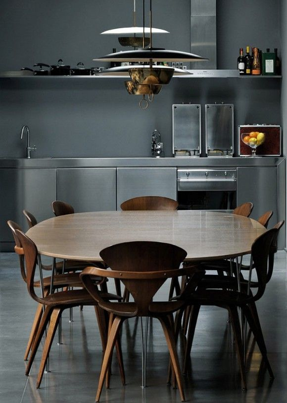 such a kitchen where the wood and curvy chairs combine amazingly with the grey cabinets