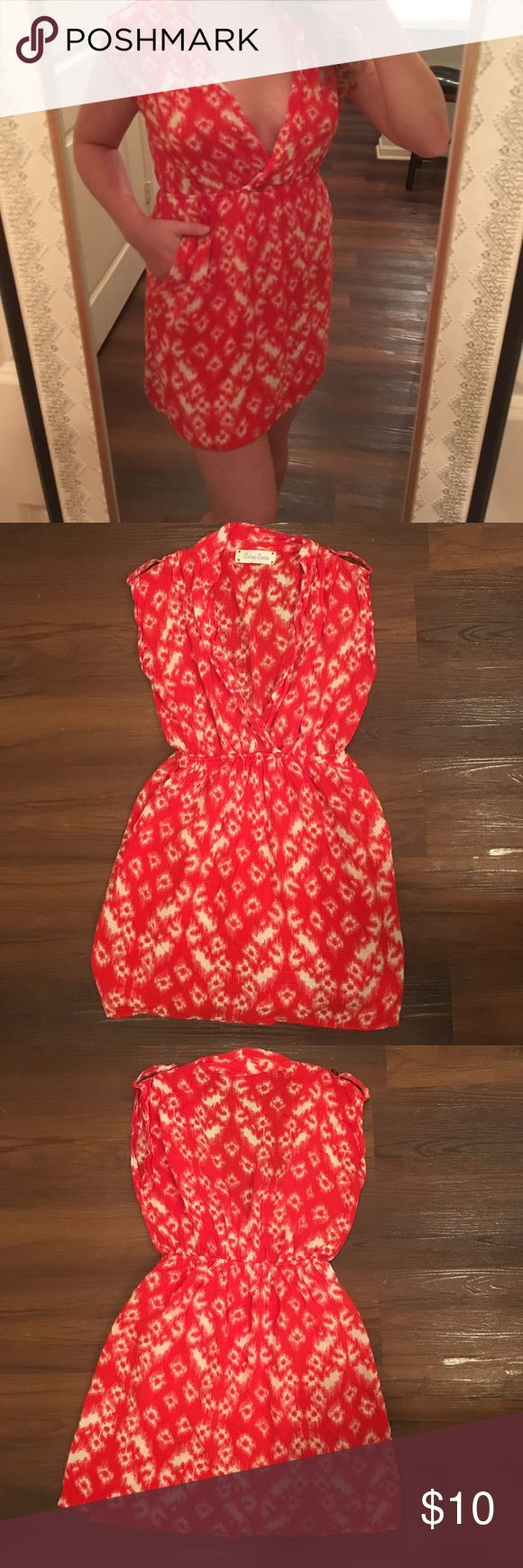 Blood Orange Mini Dress Vibrant red-orange Mini Dress with a white pattern and pockets. The skirt of the dress has an inner lining to aid in support and peace of mind when the wind blows. Good condition. Willing to accept bundles/offers, if fair. Criss Cross Dresses Mini