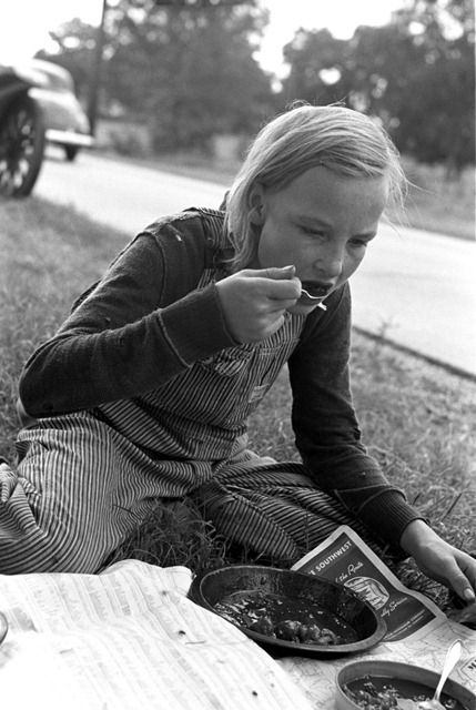 Daughter of white migrant eating lunch along the highway east of Fort Gibson, Muskogee County, Oklahoma -- Eyes of the Great Depression 119.