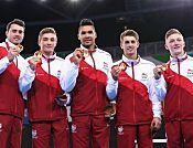 Flippin' marvellous: Louis Smith helps Team England secure gymnastics gold in Glasgow. THE cheer as Louis Smith walked out was testament to his celebrity status as winner of Strictly Come Dancing as much as being an Olympic star but by the end of the day they were roaring for ten English stars.