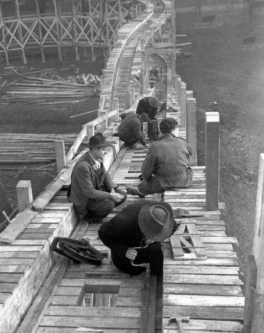 theniftyfifties: Workmen building the 'Big Dipper' in Battersea Park in 1951.