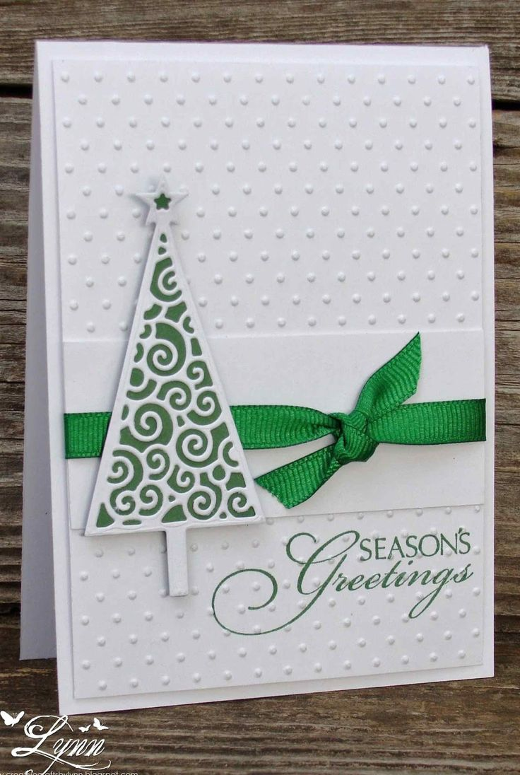 handmade Christmas card from Creative Crafts by Lynn ... clean and simple ... white and green ... triangle tree ... Swiss dot embossing folder texture on the background ...