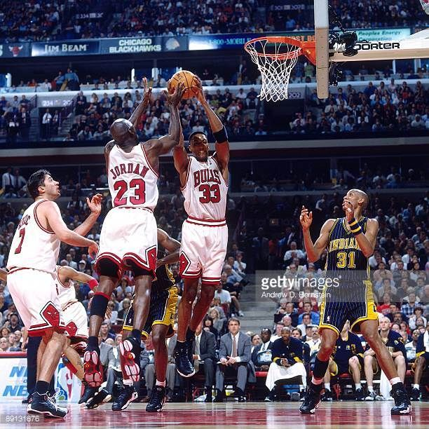 Scottie Pippen and Michael Jordan of the Chicago Bulls team up for a rebound against the Indiana Pacers in Game Five of the Eastern Conference Finals...
