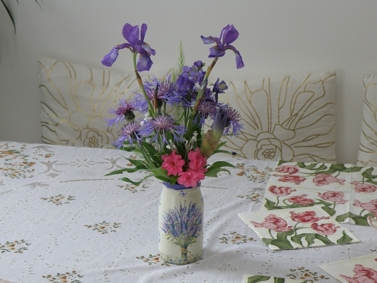 Spring in blue. Water Iris with cornflowers and little rose azalea brokes the blue.
