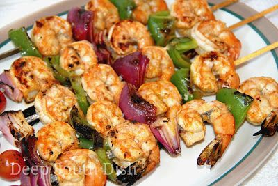 Cajun Grilled Shrimp Skewers - Jumbo shrimp, tossed in an olive oil and lemon Cajun seasoned marinade, skewered with onion, bell pepper and tomato and grilled.