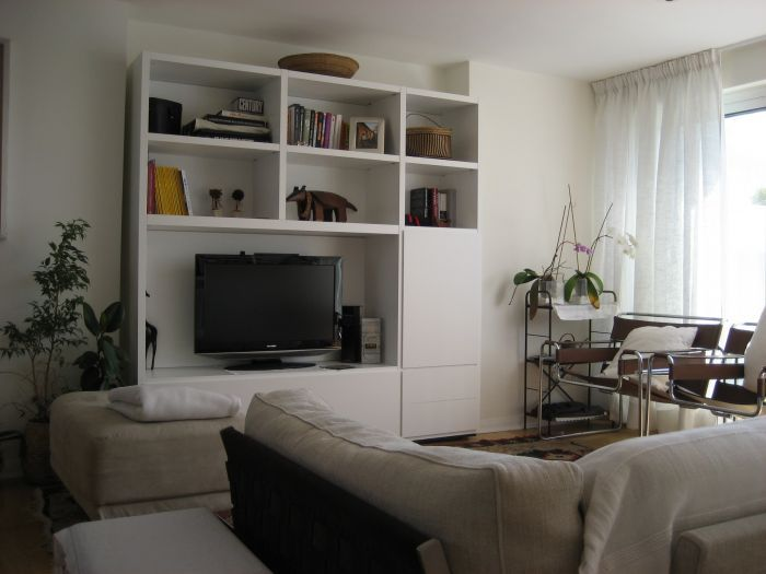 Supply of items to complete the furnishing of London flat: #Cestone #Flexform sofa and Wall System #Poliform #bookshelf.