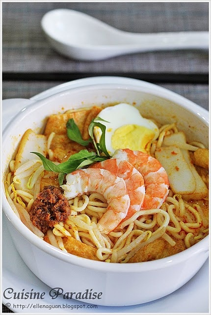 """Laksa(叻沙) is a popular spicy noodle soup dish origin from the Peranakan culture, which is a merger of Chinese and Malay ingredients. Basically there are two types of Laksa such as """"Curry Laksa"""" and """"Asam Laksa(Penang Laksa)"""". Curry laksa used coconut curry as soup base together with noodles, tau po, bean sprout, prawns and etc while Asam laksa is a sour fish soup with noodles."""