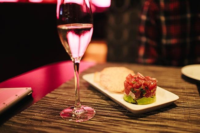 A glass of Ruffino Prosecco and Ahi Tuna Poke from Hotel 1000's Boka Bar + Restaurant