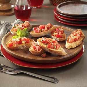 GARLIC TOMATO BRUSCETTA: olive oil, fresh basil, garlic cloves, salt, pepper, 4 medium tomatoes, grated Parmesan cheese