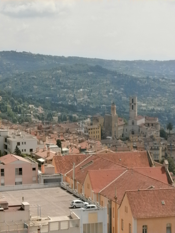 From the balcony of our hotel room we could look down on the historic centre of Grasse. Using a telescopic lense, I obtained this photograph of the Cathedral of Grasse, and the adjoining City Hall.