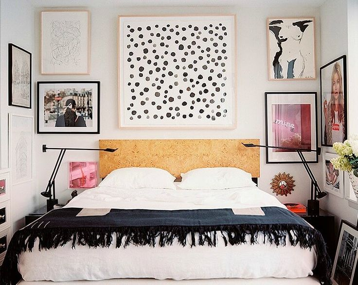 cork style headboard with large black and white polka dot artwork above bed