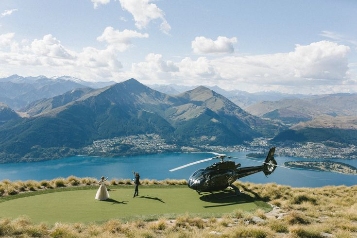 The beautiful ceremony of Alex & Lisa of @2people1life.  Delighted to dress both the beautiful #bride & the handsome #groom! #queenstown #newzealand #wedding #lake #mountain #overthetop #helicopter @emilyadamson photography  / @ottheli helicopter / @nemoworkroom dress and suit http://2people1life.com/blog/