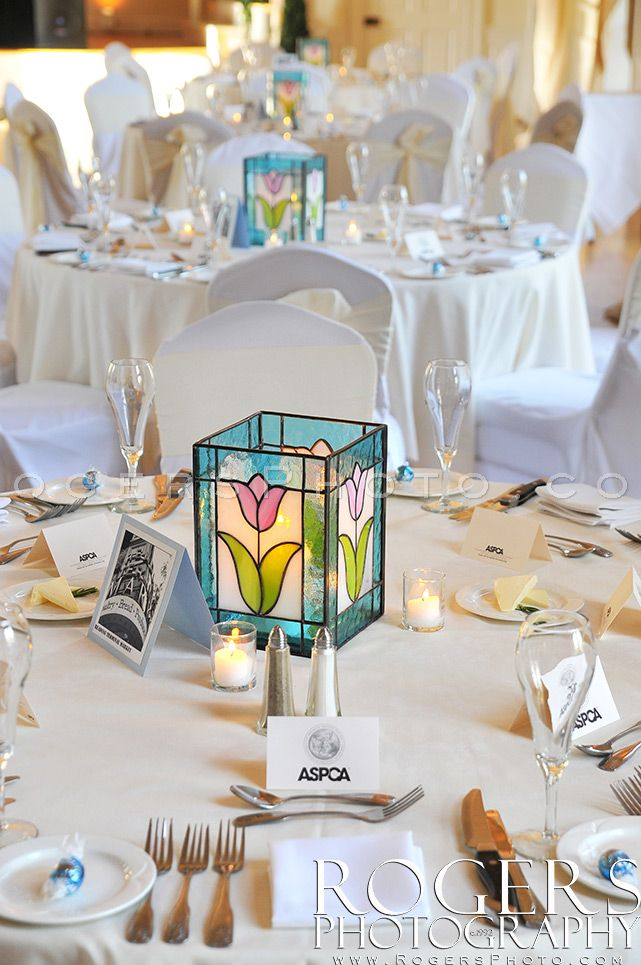 Simple table setting with custom hand made stained glass lanterns by the M.O.B. Rogers Photography