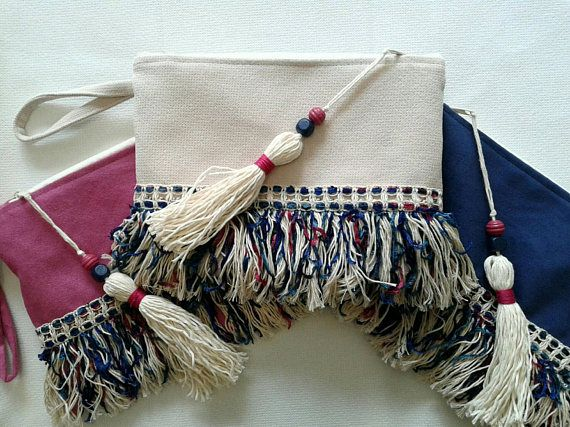 Check out this item in my Etsy shop https://www.etsy.com/listing/522542809/boho-chic-wristlet-clutch-with-colorful