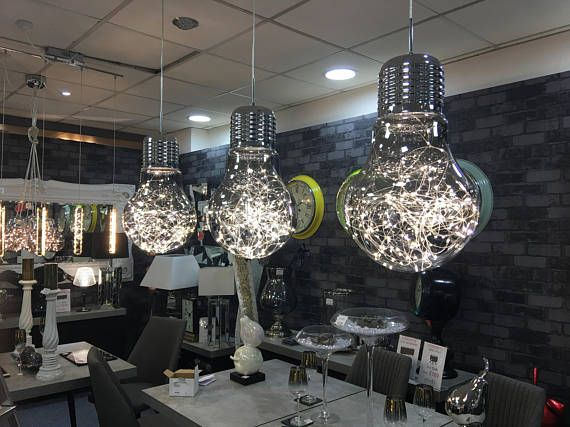 MODERN RETRO CEILING LIGHT CHANDELIER LARGE OVERSIZED GLASS LIGHT BULB FILLED WITH HUNDREDS OF INDIVIDUAL LEDS TO GIVE A STUNNING SPARKLE EFFECT EACH BEAUTIFULLY CRAFTED LIGHT IS FINISHED IN POLISHED CHROME & COMPLIMENTED WITH SMOKED GLASS MATCHING POLISHED CHROME BASE WHICH ALSO