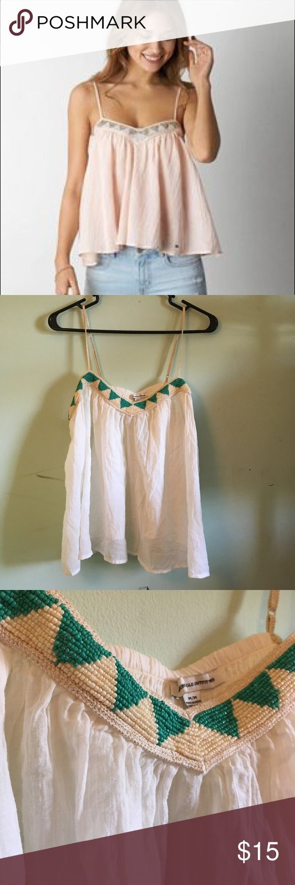 AE White Beaded Camisole American Eagle white camisole/Tank with teal and cream white beads. Flowy and comfortable. Adjustable pink sparkley straps. See through so be sure to wear a white bra or something underneath. Model is wearing same item in pink! Size medium. American Eagle Outfitters Tops Camisoles