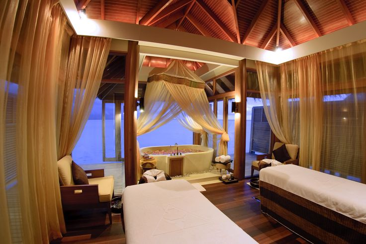 Overwater spa bungalow for a couples message at the for Spa vacations for couples