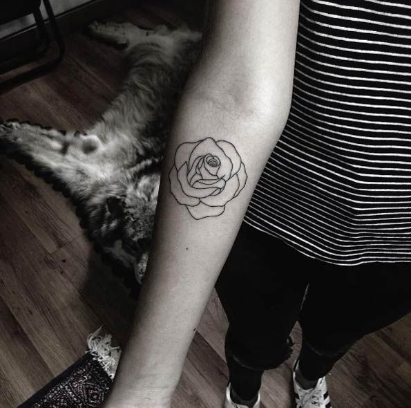 Minimalistic rose tattoo by Mateo Gonzalez