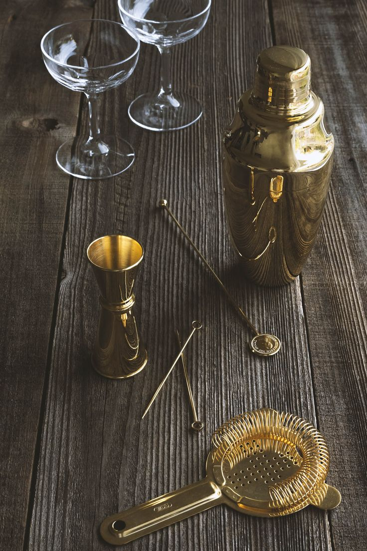 Umami Mart - Gold-plated cobbler shaker, a gold-plated jigger, two coupe glasses, a Queen Elizabeth swizzle stick, and two gold circle cocktail pins