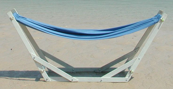 www.dreamtimehammocks.co.za The Dreamtime Eazilay wooden hammock stand on beach - comes in a variety of finishes. Dark, Natural and White Wash.