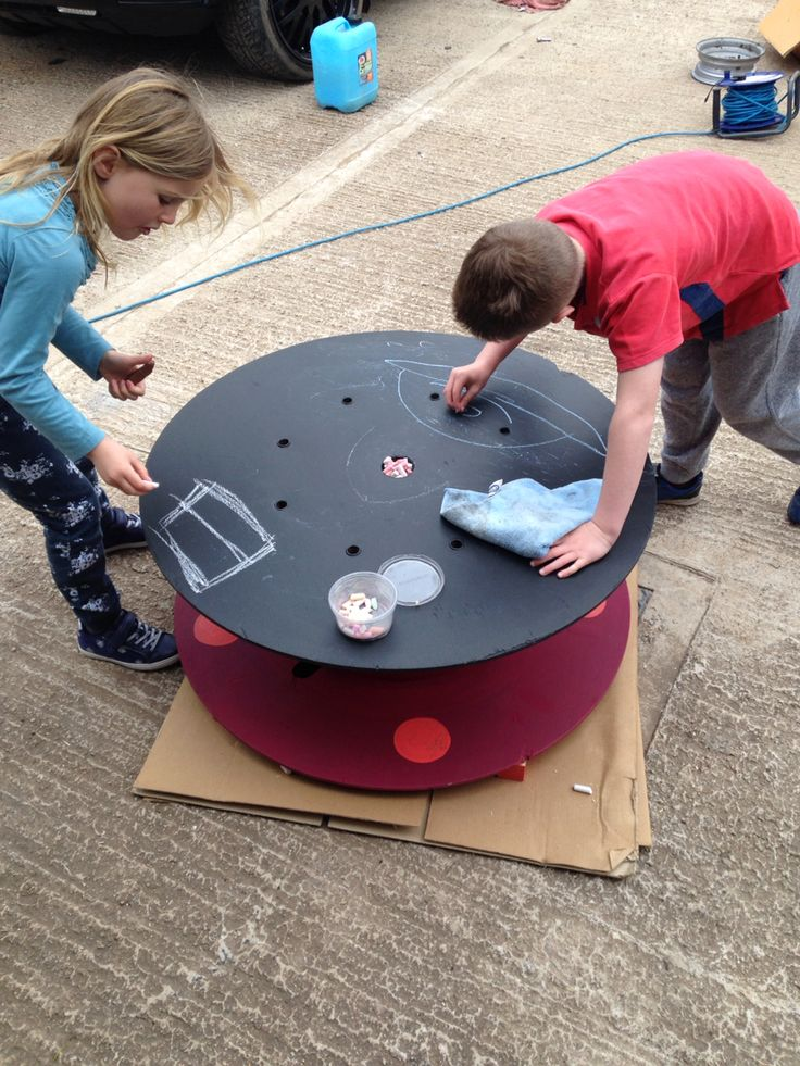 My niece & nephew trying out our new chalkboard table made from an old cable reel. M_LDx