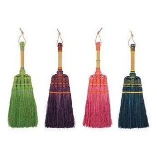 Short Broom - If you need a short broom at easy access, it might as well be good looking. These brooms have fun bright colors and detail at the top of the broom head that make them stand out.