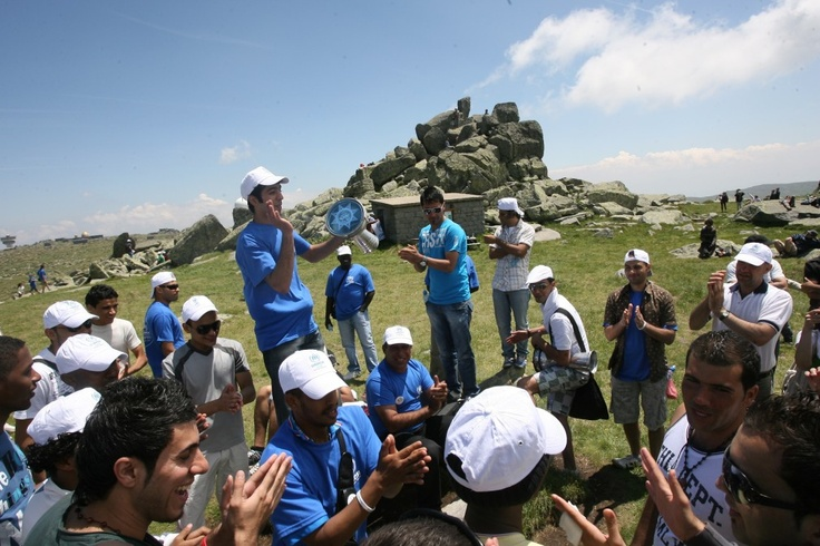 Refugees and asylum-seekers who took part in a two hour hike to the top of Vitosha Mountain celebrate World Refugee Day by singing and playing instruments. © UNHCR/B. Kichukov/June 2011