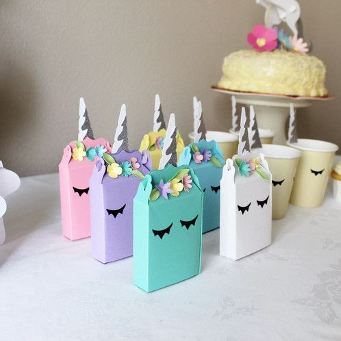 Choose your custom color for these unicorn favor boxes. Set of 2 favor boxes in chosen color. Each box is 5 inches by 3 inches. Decorated with one inch eye lashes and 3 inch glitter unicorn horns. Choose Gold or Silver. Adorned with pastel colored florals. Fits crayons and other small favor goodies.
