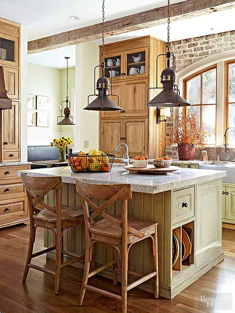 Suspended above prep stations and tabletops, rustic lighting fixtures bring pretty profiles to the space between surfaces and ceilings. This homeowner used a trio of rustic pendants with the contours of factory work lights to keep interest high in the kitchen and adjacent eating area. /