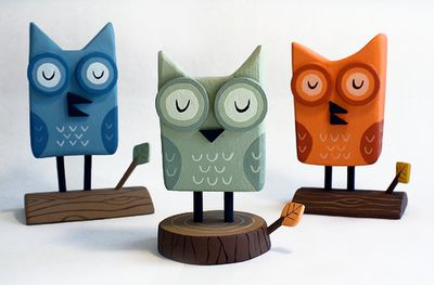 Owls made from recycled wood. Coat hanging rods for eyes, fence post for the perches