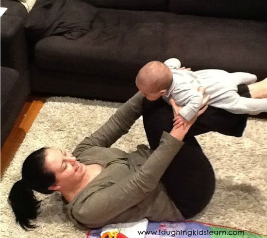 tummy time on your legs - great new parent ab workout and fun for baby
