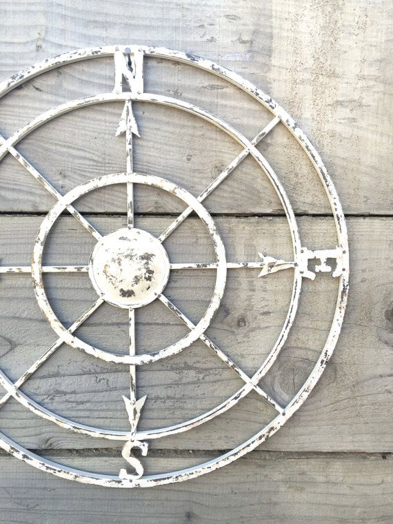 This elegant, rustic, large metal compass displays as a lovely piece of wall art in the home. This beautiful piece is carefully hand painted in