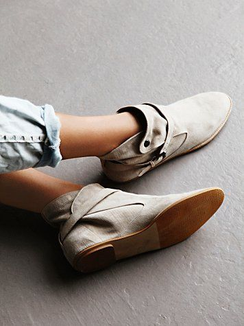 Ties to Simplicity Boot   Soft suede ankle boots with slouchy ankle wrap and single snap closure. Subtle perforated detail over heel. Adjustable ankle strap. *By Free People