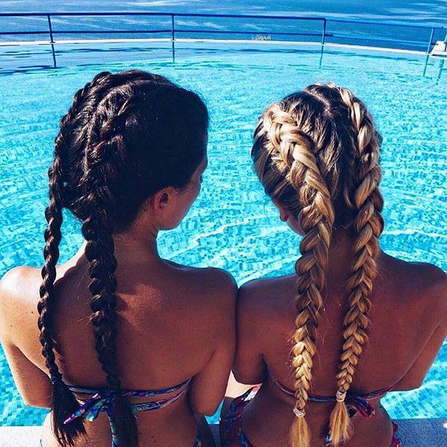 Double long pony tail braids.