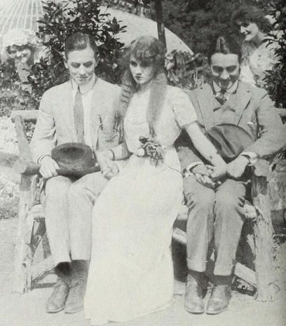 "Florence Lawrence is caught in the middle of a romantic triangle with Matt Moore (left) and Owen Moore, in the 1912 film, ""Tangled Relations."""