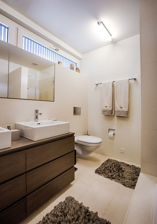 Bathroom in natural Stone and custom-made wooden furniture, Switzerland