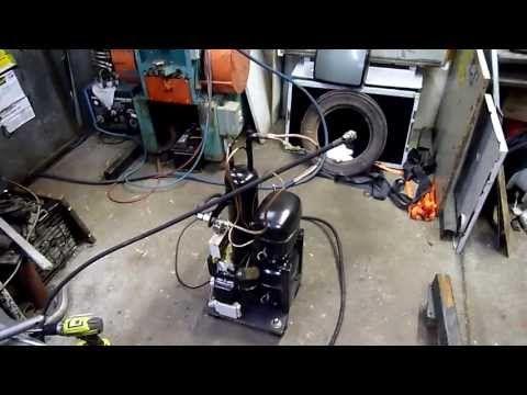 High pressure air compressor using a pair of refrigeration compressors | Hackaday
