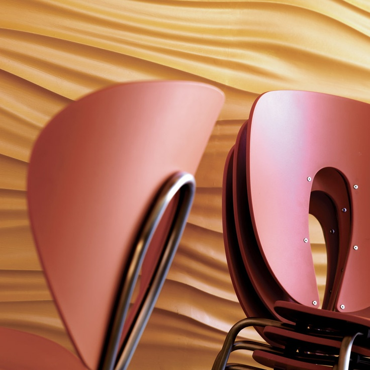 Globus chairs in orange polipropilene, with stainless steel frame, both for indoor & outdoor; by STUA.