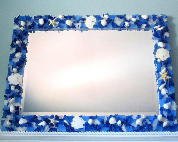 Beach decor sea glass custom mirror, nautical decor seaglass mirror, coastal decor beach glass custom mirror in blues,  $1100.   https://www.beachgrasscottage.com/