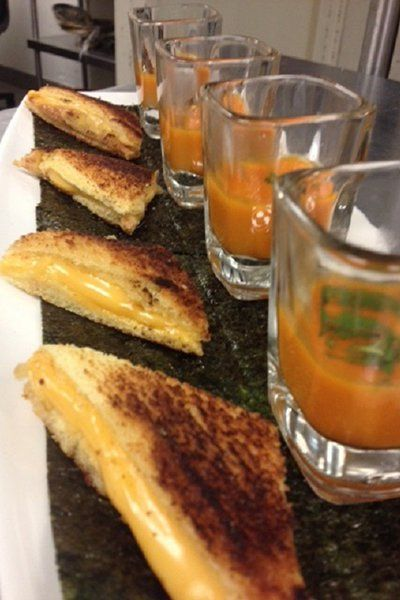 Who doesn't love melty grilled cheese? Try this mini comfort food accompanied by tomato soup shooters.