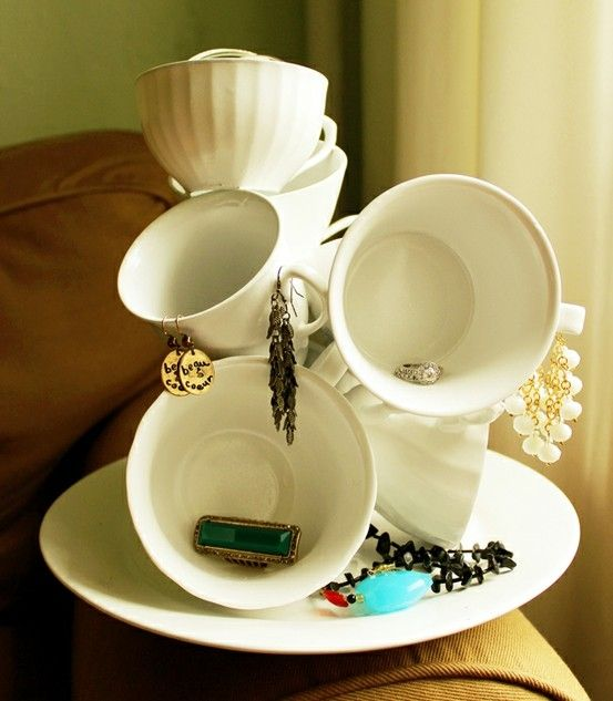 Dollar store tea cups hot-glued for bathroom storage