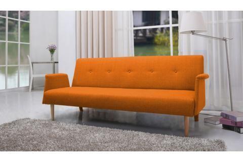 Photo de canapé moelleux orange dans salons cosy → touslescanapes.com