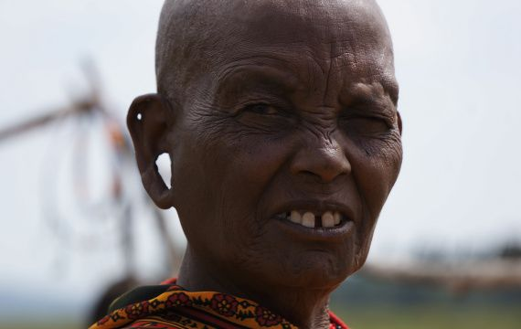 Loops in the ears are a sign of beauty, Masai Woman Tribe Kenya